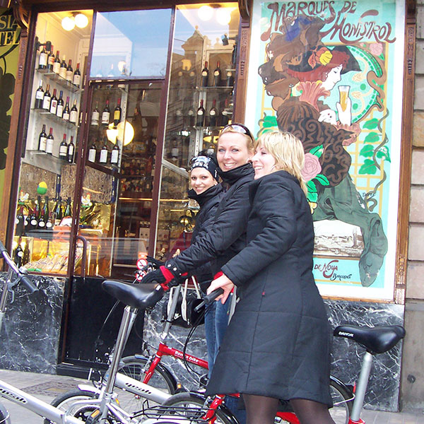 Bike tour in front of modernist shop